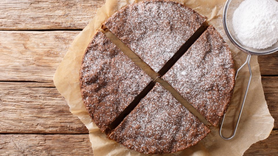 Swedish Traditional Dessert: Kladdkaka Chocolate Sticky Cake With Powdered Sugar Close Up Horizontal Top View From Above