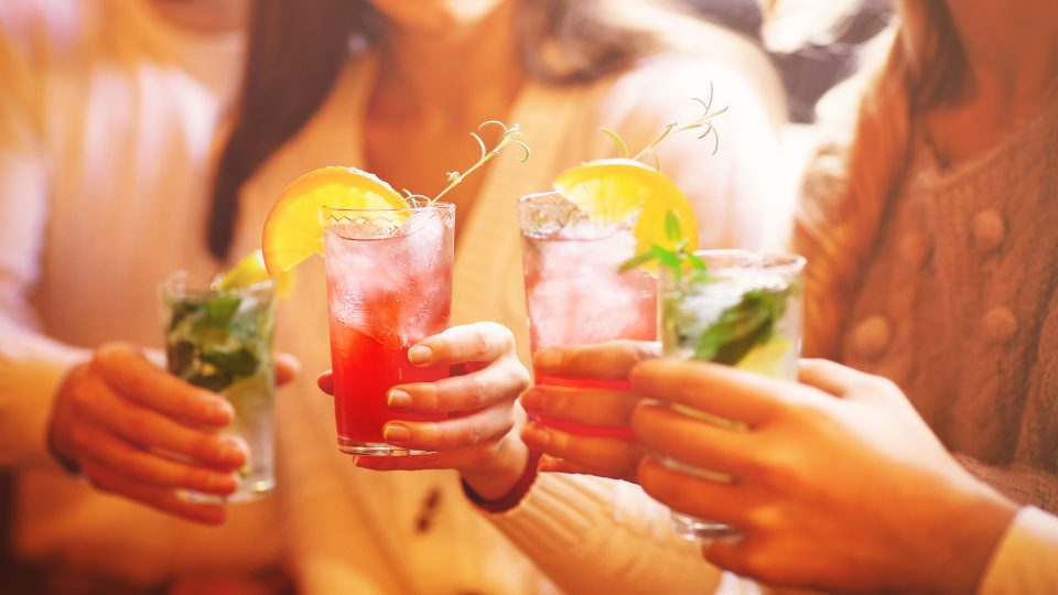 Friends Drinking Non-Alcoholic Cocktail At Party
